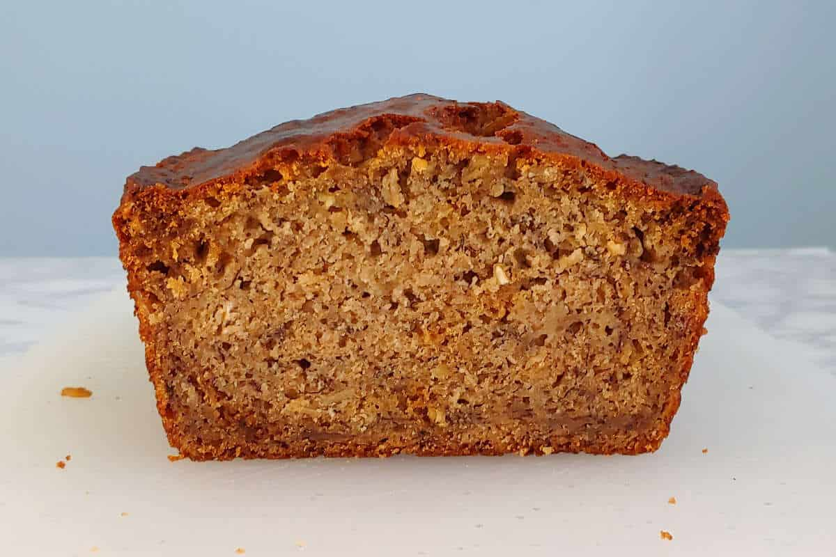 a cut loaf of banana bread, seen from the side