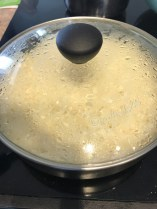 Cover the rice and let it cook on lowest flame, covered and undisturbed