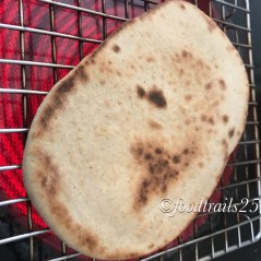 Cook the top side of Naan