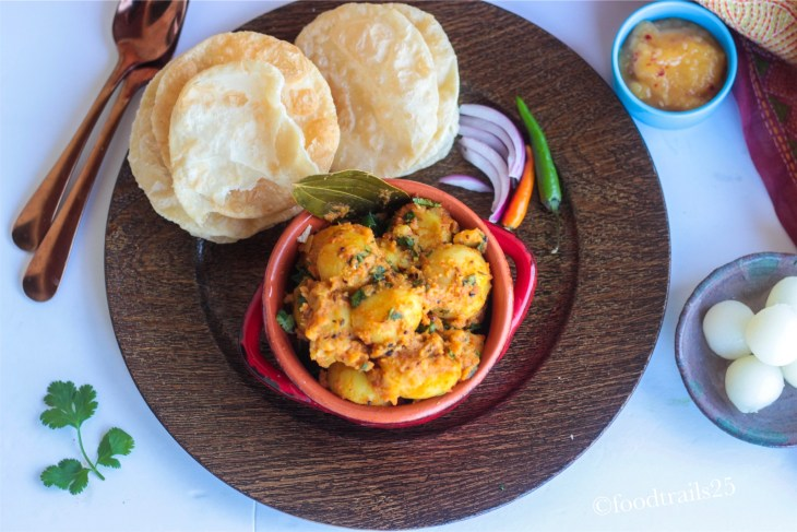 Luchi Aloo is a popular breakfast combo from Bengali Cuisine. Luchi is Poori(fired flatbread) made with All-purpose flour and Aloo is spicy Potato gravy that is served with Luchi.