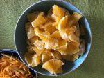 Finely chop oranges