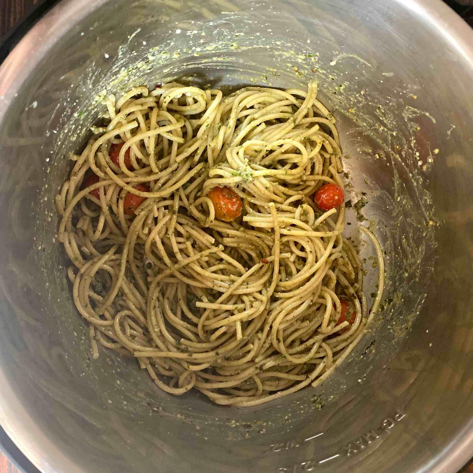 Mix lightly coating Spaghetii with pesto