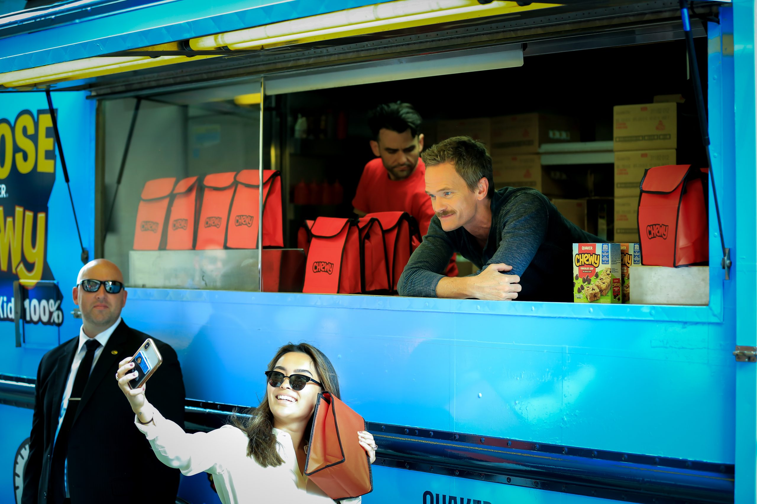 Neil Patrick Harris visits Chewy food truck NYC for adoptaclassroom promotion