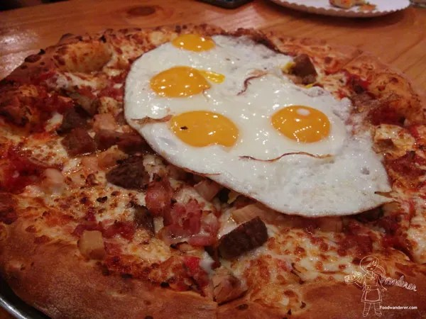 Out of the park pizza: The Eggcellent made with scrambled egg or sunny side up, sausage, bacon, and buffalo sauce. 14' $15
