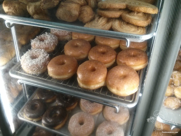 Palmier, coconut shaved donuts, glazed donuts, chocolate covered donuts, and sugar coated donuts
