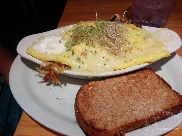 The Gros Ventre Slide $9.75 the ultimate one-dish meals! green chilies & cheddar cheese melted over two fried eggs and hash browns, garnished with sour cream & sprouts