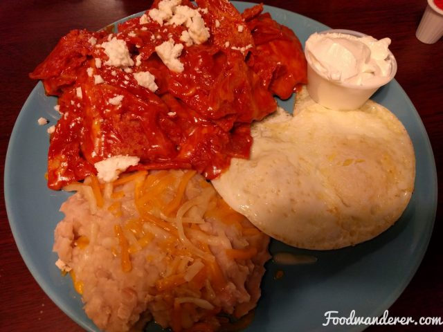 Chilaquiles, beans, and eggs over easy