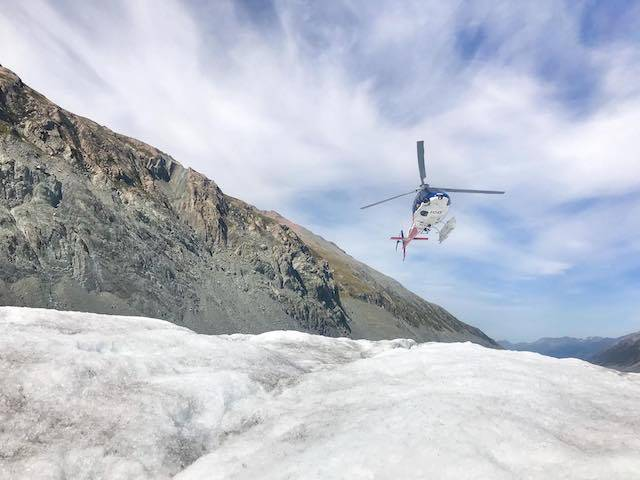 Mount Cook NZ Helicopter Landing On Ice