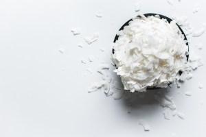 shredded white coconut on white background