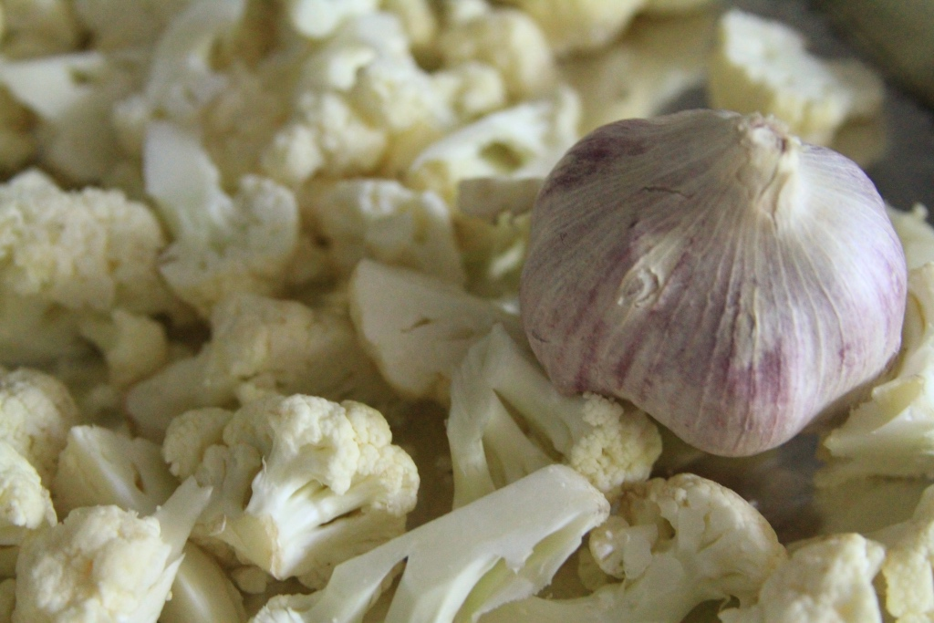 chopped cauliflower and whole purple garlic