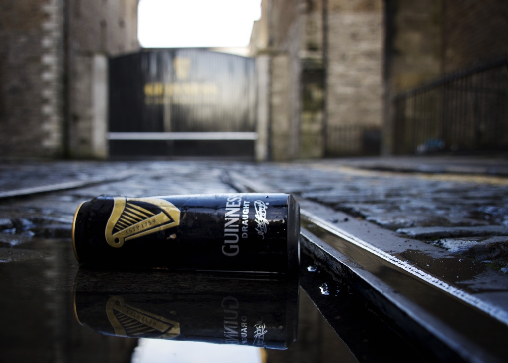 Empty can of Guinness in puddle in front of St. James Gate in Dublin | Discovering Guinness on foodwithaview.com