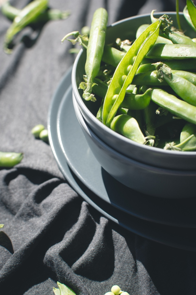 Green spring peas in a bowl for spring seasonal salad | photo by foodiesfeed | Satis Bistro restaurant review | foodwithaview.com