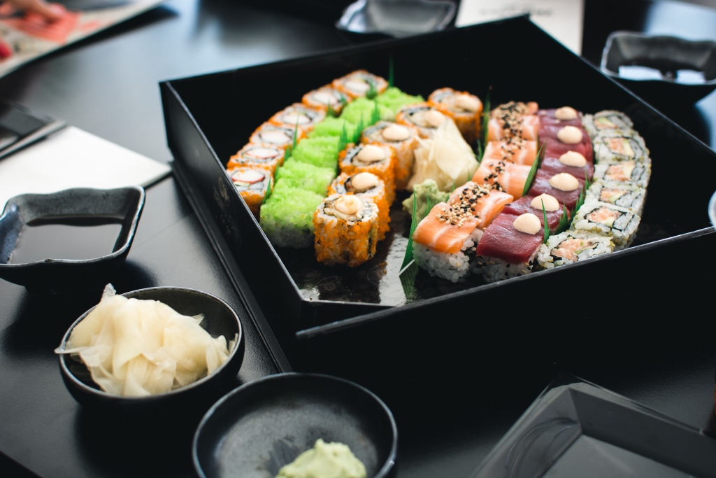 colorful sushi in a black box by foodiesfeed | valentines day alternatives | foodwithaview.com