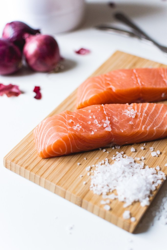 raw salmon fillets with flaky salt by foodiesfeed | valentines day alternatives | foodwithaview.com