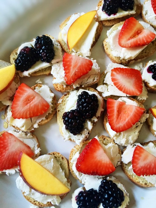 Berries and mango with goat cheese on crostini | planning a baby shower on foodwithaview.com