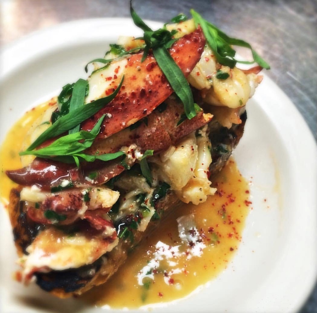 Lobster crostini in a puddle of butter sauce | 100 Steps on foodwithaview.com | photo by localrootscranford
