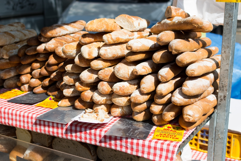 Stacks of fresh bread at a local farmers market | photo by foodiesfeed | shop local for food and kitchen supplies in northern NJ | foodwithaview.com