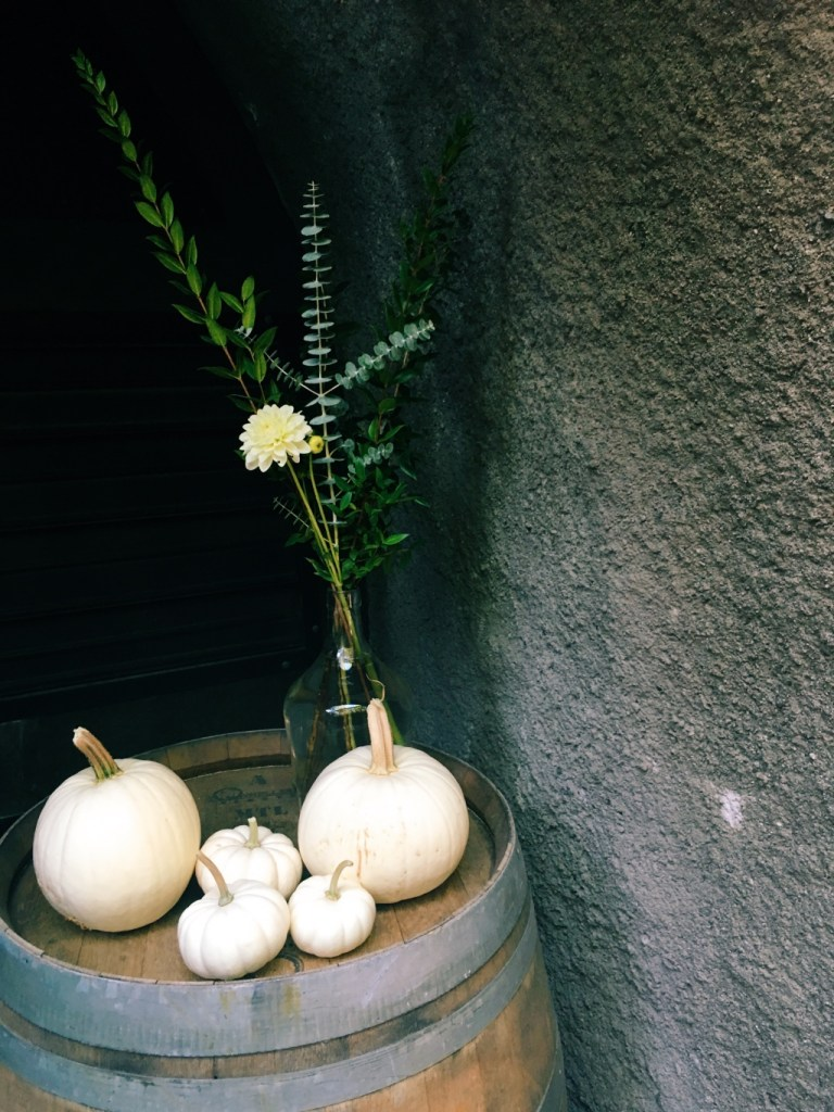 White pumpkins on a barrel at the entrance to the wine caves in napa valley | adventures in wine country on foodwithaview.com