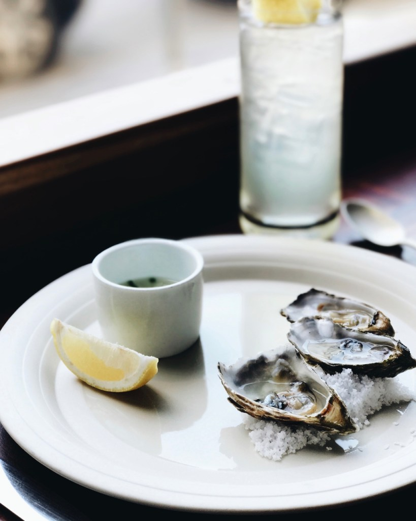 Oysters on a bed of salt | Cull and Pistol Restaurant | photo by Marie France Latour | NYC Restaurants on foodwithaview.com