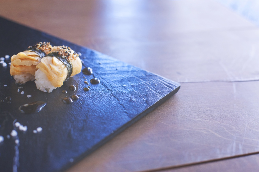 Simple sushi on a slate board | Omakase at Sushi of Gari | photo by Kuba Boski | NYC Restaurants on foodwithaview.com