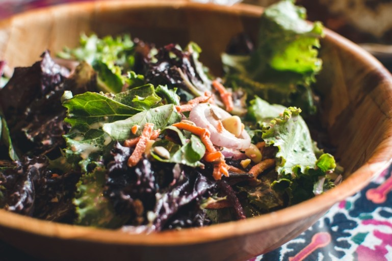 Green salad with mustard vinaigrette in a wooden bowl | photo by foodiesfeed.com | Fall parties and entertaining by foodwithaview.com
