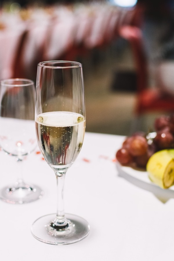 Half a glass of champagne at a wedding | Guide to champagne and sparkling wine on foodwithaview.com