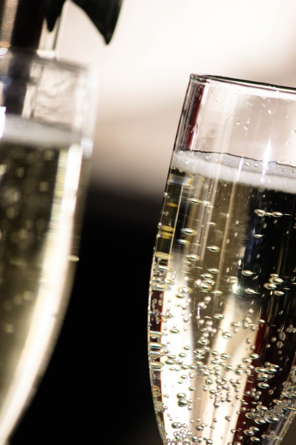 Sparkling wine or champagne in tall flutes | all about sparkling wine and champagne alternatives on foodwithaview.com