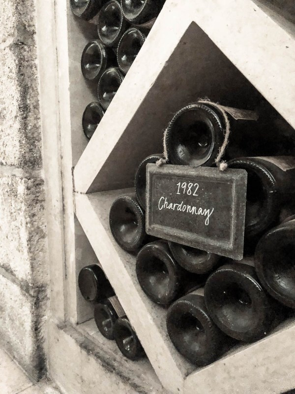 Vintage 1982 Chardonnay in storage | photo by Jenn Kosar | Holiday Food and Wine Pairings and Holiday Wine Gifts | foodwithaview.com