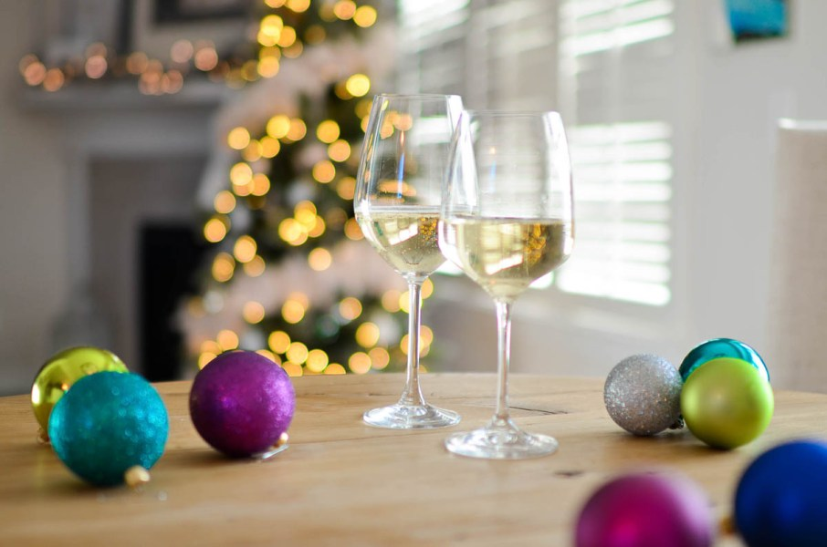 White wine with holiday decorations | Holiday Food and Wine Pairings and Holiday Wine Gifts | foodwithaview.com