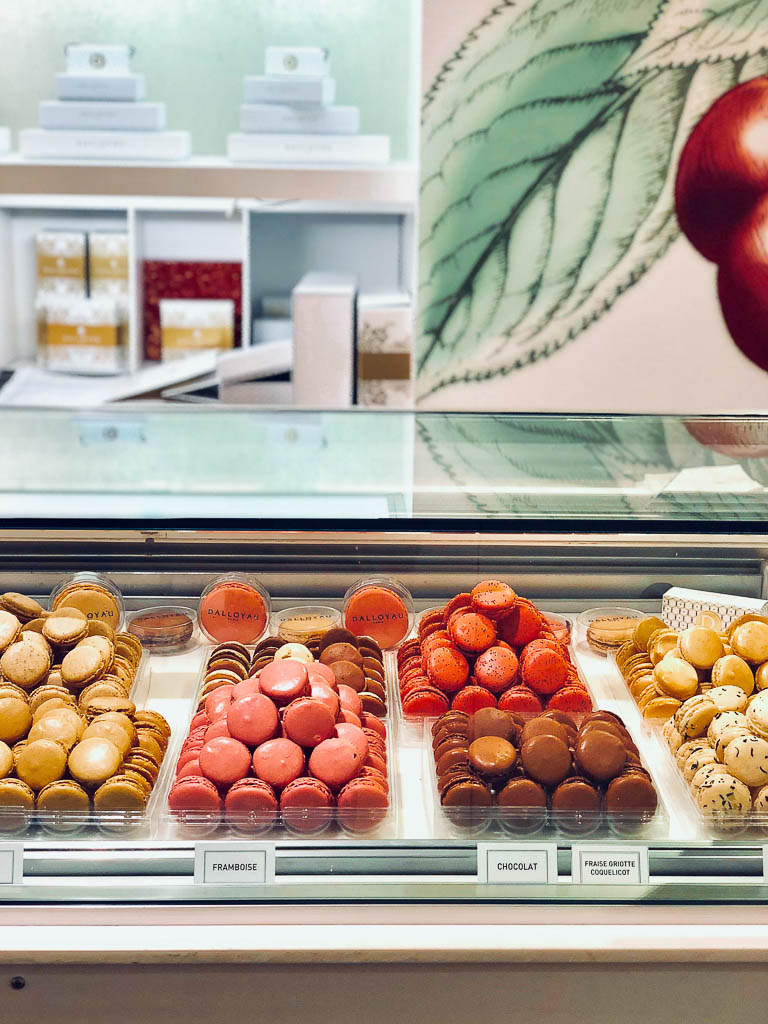 What to eat on a trip to Paris | Macarons in the window in Paris | Restaurants, cafes, food markets and more | Culinary adventures in Paris on foodwithaview.com