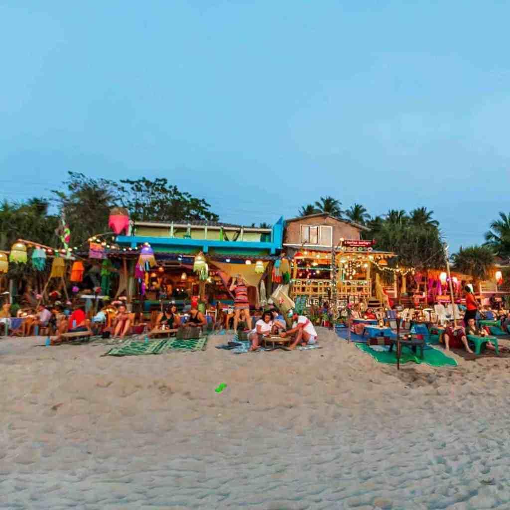 Image of people enjoying the beach in front of Charlee Barley Bar in Koh Lanta, Thailand