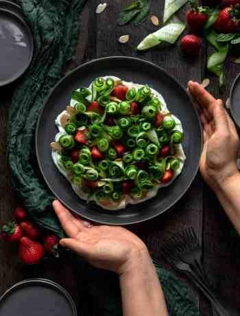 cucumber strawberry salad being presented