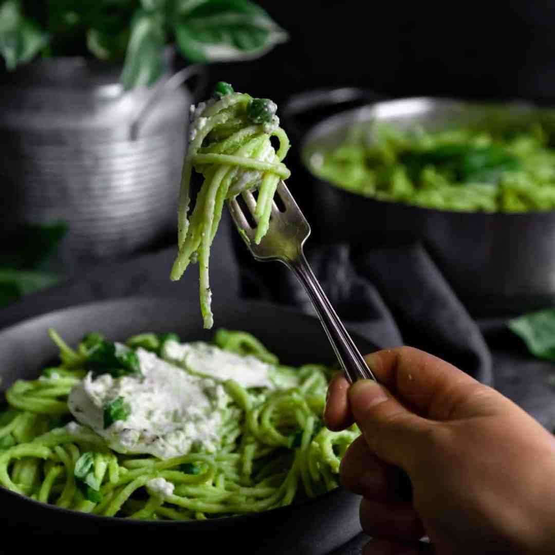 A bite of Green Pea Pasta on a fork