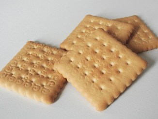 Semi-digestive biscuits, square ones on a white background.