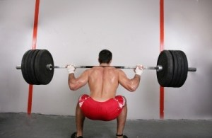 A man lifting weights. Photo by David Castillo Dominici. Courtesy of FreeDigitalPhotos.net