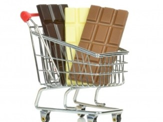 Three bars of chocolate in a shopping trolley. Chocolate is rich in cocoa polyphenols.