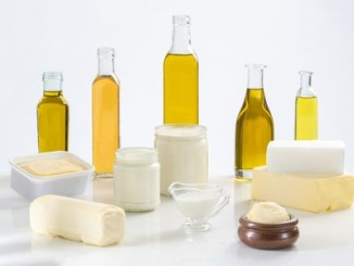 Culinary variety of fats on white background