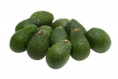 Whole avocados on a white background. A good source of manganese.