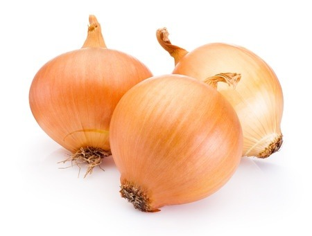 Three onion bulbs isolated on white background. Onions are a good source of quercetin.