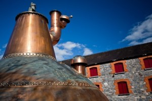 A whisky distillery showing its copper construction.