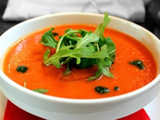 Tomato Gazpacho soup in a white bowl.