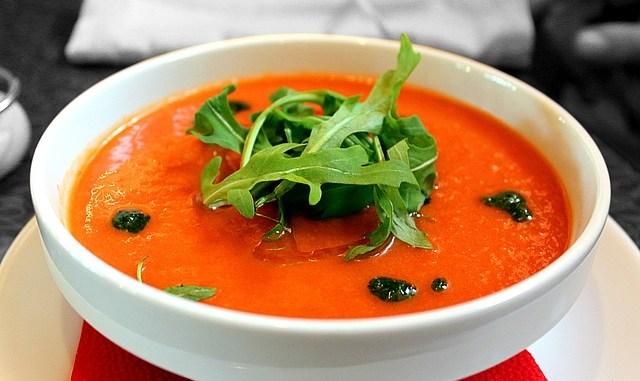 Tomato Gazpacho soup in a white bowl.