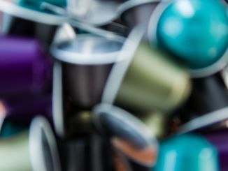 Colored coffee capsules blurred for background