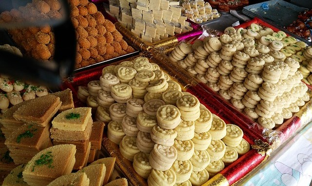 selection of indian sweets, including chum chum