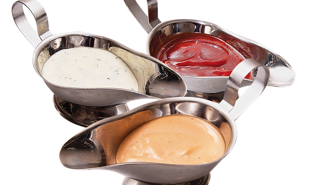 Basic sauces in a sauce boat on a white background.