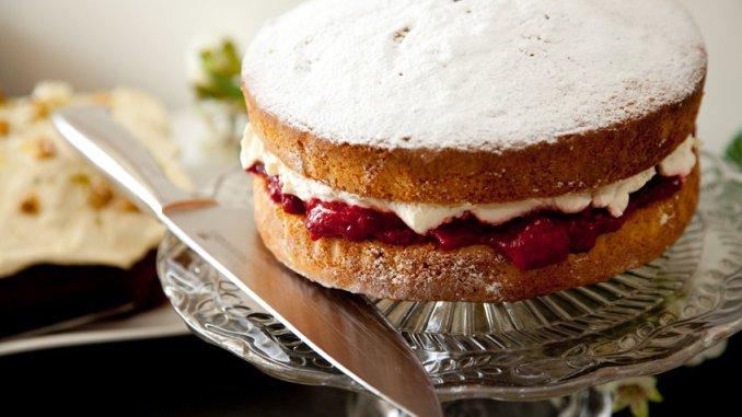 Victoria sponge cake on glass plate