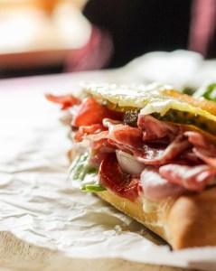 mini roll with bacon, lettuce, onions sandwich