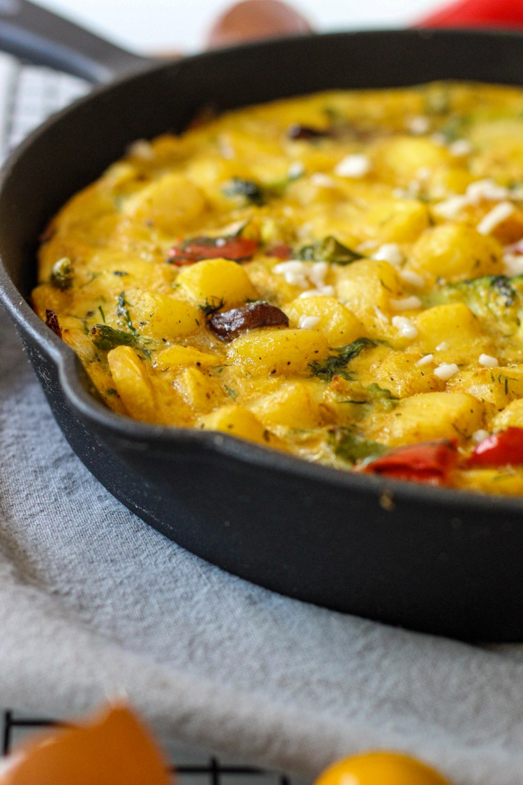 omelette in a cold cast pan with vegetables