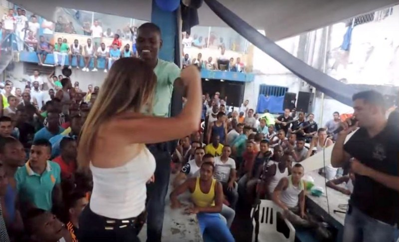 "Pic shows: Claudia Patricia Giraldo Ossa, prison director, dances with inmates. A blonde prison director who twerked in front of hundreds of sex-starved jail inmates is facing an inquiry in Colombia. Curvy Claudia Patricia Giraldo Ossa - head of the prison in Cali - appears in a series of steamy photos from inside the jail dancing erotically at a prisoners' ""cultural event."" Ossa - wearing a shoulder revealing halter necked top, skin tight jeans and stilettos - jumped up on stage and was pictured performing a sexy bump and grind routine with a series of baying prisoners. Others packing Villahermosa Jail's Courtyard 5 cheered her on without a single prison guard in sight. Colleagues say Ossa had not intended to perform at the event but had got carried away when inmates called for her to get up on a makeshift stage. Local media reports she has not commented on the scandal. Officials say she now faces an inquiry into discipline at her jail. The scandal emerge as Colombia's new Minister of justice, Jorge Londono, declared a state of emergency in the country's prisons. Overcrowding is said to be causing severe problems with drug abuse and violence with msot jails struggling with occupancy levels of more than 150 per cent. (ends)"