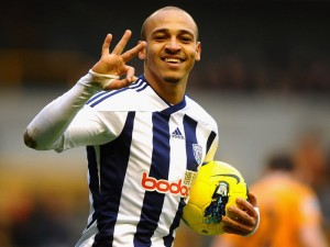 Peter Odemwingie scored a hat-trick for West Bromwich Albion in their 5-1 win over Wolverhampton Wanderers at Molineux.